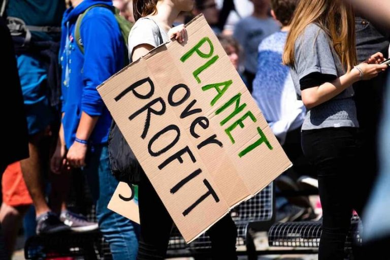 eco friendly sign planet over profit